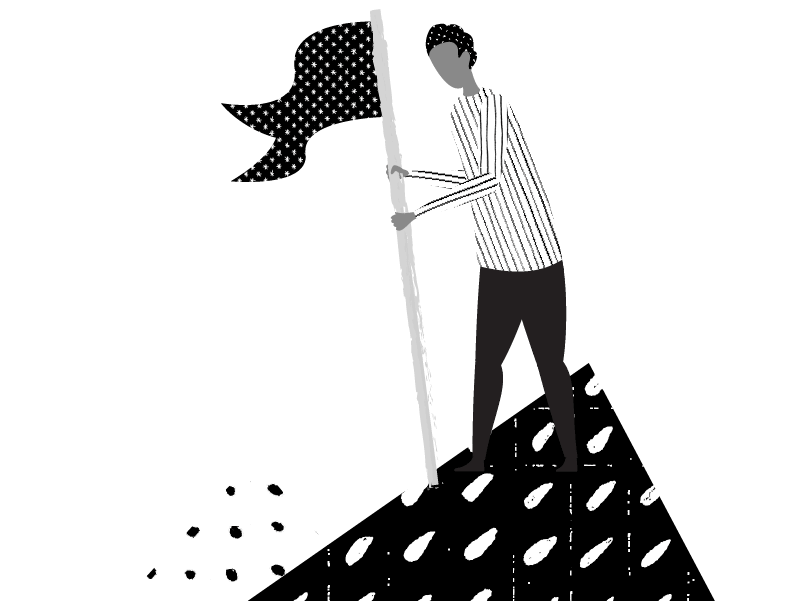 person planting flag on top of mountain